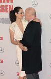 Bruce Willis and Emma Heming. BERLIN - GERMANY - FEBRUARY 4: Bruce Willis and Emma Heming at the A Good Day to Die Hard premiere at CineStar, Sony Center Royalty Free Stock Photo