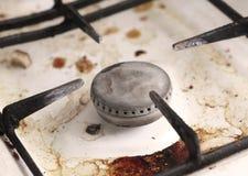 Bruciatore di vecchio fornello di gas sporco Immagini Stock