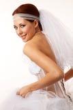 Bruden kasta en blick över henne knuffar Royaltyfria Foton