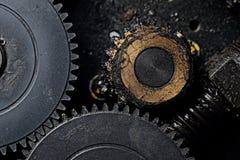Brudni gearwheels w pracie makro- Obraz Stock