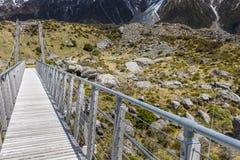 Brug over Hooker Rivier in het nationale park Nieuw Zeeland van Aoraki Royalty-vrije Stock Afbeelding