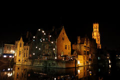 Bruge canal & the Belfry at night. Christmas night picture in Bruges showing canal the Belfry Tower, cloth hall and typical illuminated Belgium architecture Stock Images