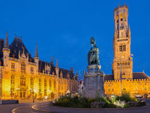 Bruge - Grote markt in evening dusk. Belfort van Brugge and Provinciaal Hof buildings Stock Photo