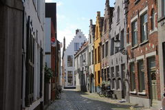 Bruge Street View. Bruges has most of its medieval architecture intact. The historic centre of Bruges has been a UNESCO World Heritage Site since 2000 Stock Photos