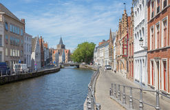 Brugeds - Typically house over the canal from Sint Annarei street and st. Giles church in the background. Royalty Free Stock Photos