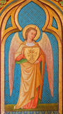 Bruges - Archangel Gabriel paint from side altar in st. Giles (Sint Gilliskerk). Stock Images