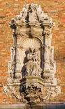 Bruges - The Baroque statue of Madonna on the facade of Belfort van Brugge. Royalty Free Stock Photo
