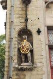 Bruges bear sculpture. Figure of bear holding the coat of arms (emblem of jousting association De Witte Beer). Facade of Poortersloge (Burghers Lodge) building Stock Image