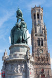 Bruges - The Belfort van Brugge and memorial of Jan Breydel and Pieter De Coninck on the Grote Markt Royalty Free Stock Photography