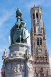Bruges - The Belfort van Brugge and memorial of Jan Breydel and Pieter De Coninck on the Grote Markt Royalty Free Stock Photography
