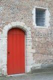 Bruges, Belgium. Door and window on a brick wall, Bruges, Belgium Stock Photo
