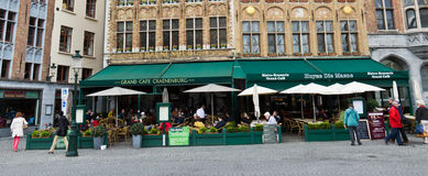 BRUGES/BELGIUM - April 14, 2014:  Tourists at restaurants in the Royalty Free Stock Photography
