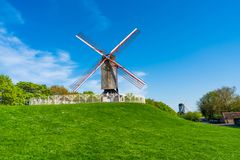 The windmills in Bruges, Belgium. BRUGES, BELGIUM - APRIL 22, 2018: The windmills of Bruges sit on a pathway around the edge of the old city boundary. Some are Stock Photos