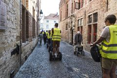 Tourists on a Segway tour in Bruges, Belgium royalty free stock photo