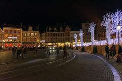 People on the large Market Square Markt in the centre of Bruges, night scene stock images