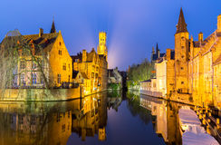 Bruges, Belgium at dusk. Historic medieval buildings along a canal in Bruges, Belgium at dusk Stock Photo