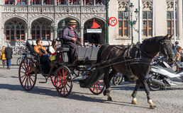 BRUGES, BELGIUM/ EUROPE - SEPTEMBER 25: Horse and carriage in Ma Stock Photography