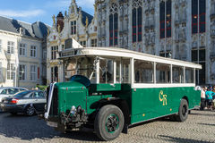 BRUGES, BELGIUM/ EUROPE - SEPTEMBER 25: Old bus outside the Prov. Incial Palace in Market Square Bruges West Flanders Belgium on September 25, 2015. Unidentified royalty free stock image