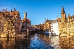 Bruges, Belgium. Image with Rozenhoedkaai in Brugge, Dijver river canal and Belfort (Belfry) tower Stock Images