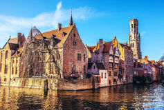 Bruges, Belgium. Image with Rozenhoedkaai in Brugge, Dijver river canal and Belfort (Belfry) tower Stock Photo