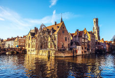 Bruges, Belgium. Image with Rozenhoedkaai in Brugge, Dijver river canal and Belfort (Belfry) tower Royalty Free Stock Image