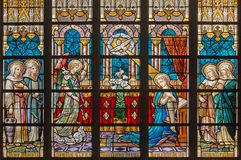 BRUGES, BELGIUM - JUNE 12, 2014: The Annunciation on windowpane in St. Salvator's Cathedral (Salvatorskerk) by stained glass artis Stock Image