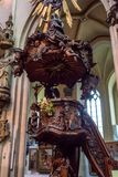 BRUGES, BELGIUM - JUNE 10, 2014: Wooden pulpit in Church of Our Lady in Bruges. BRUGES, BELGIUM - JUNE 10, 2014: Beautiful wooden pulpit, interior detail of Royalty Free Stock Photos