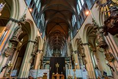 BRUGES, BELGIUM - JUNE 10, 2014: Interior of Church of Our Lady in Bruges. Its tower, at 115 metres in height, remains the tallest structure in the city Stock Photography