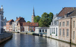 BRUGES, BELGIUM - JUNE 12, 2014: Typically house over the canal from Sint Annarei street with the st. Ann church Stock Photo