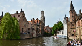 Bruges, Belgium - May 11, 2015: Bruges Belfry seen from Rozenhoedkaai in Bruges. stock video