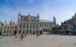 Bruges, Belgium - May 11, 2015: Tourist on Burg square in Bruges, Belgium. Royalty Free Stock Photos