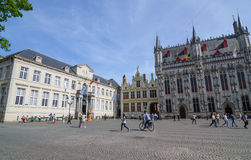 Bruges, Belgium - May 11, 2015: Tourist on Burg square with City Hall in Bruges, Belgium Stock Photo
