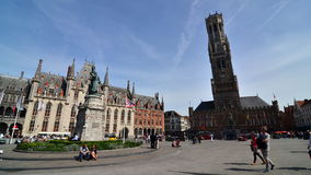 Bruges, Belgium - May 11, 2015: Tourist on Grote Markt square in Bruges, Belgium stock video footage