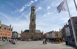 Bruges, Belgium - May 11, 2015: Tourist on Grote Markt square in Bruges, Belgium Royalty Free Stock Image