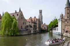 Bruges, Belgium - May 11, 2015: Tourist visit Rozenhoedkaai in Bruges, Belgium. Stock Photo