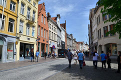 Bruges, Belgium - May 11, 2015: Tourists visit Steenstraat Shopping Street in Bruges, Belgium. Royalty Free Stock Images