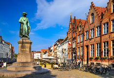 Bruges, Belgium. Medieval scenery with Yan Van Eyck square and statue. Brugge, Western Flanders Stock Images