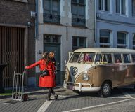 Old Volkswagen minibus on ancient street stock photography