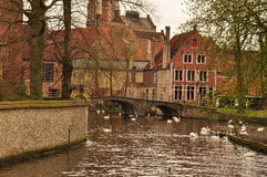 Bruges, Belgium. Old canal front buildings and bridge Stock Photo