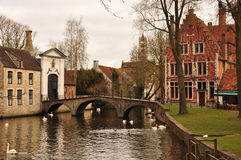 Bruges, Belgium. Old canal front buildings and bridge Stock Image