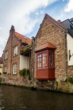 A Canal in Bruges, Belgium. Bruges, Belgium - September 14, 2017: Bruges is a Flemish city of Belgium, in the northwest of the country. Along with a few other Stock Images