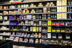 Very large choice of beers and liquors at alcohol store in cente stock images
