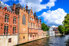 Bruges, Belgium. Summer scenery with gothic style houses and Groenerei water canal in Flanders medieval city of Brugge most famous landmark of Belgium royalty free stock photos