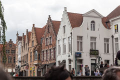 Bruges Belgium. Tourists  and the facade of the historical buildings on a street of Bruges, Belgium Stock Photography