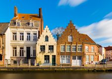 Bruges Brugge, Belgium: Street view of the old residential houses in traditional architecture style Stock Photos