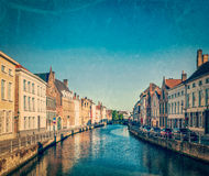 Bruges (Brugge), Belgium. Vintage retro hipster style travel image of canal and medieval houses. Bruges (Brugge), Belgium with grunge texture overlaid Royalty Free Stock Photo