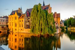 Bruges Brugge cityscape with water canal at sunset Stock Image
