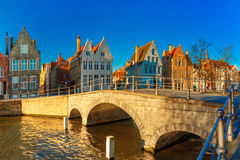Bruges canal and bridge in the morning, Belgium Stock Images