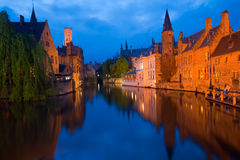 Bruges Canal Buildings Rozenhoedkaai. Beautiful brick architecture is reflected in the canal in front of RozenhoedKaai in the old city portion of Brugge, Belgium Royalty Free Stock Photo