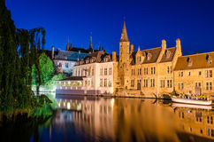 Bruges canal at night and medieval houses with reflection in wat Royalty Free Stock Photography